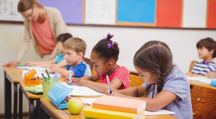 Pupils at desks with teacher